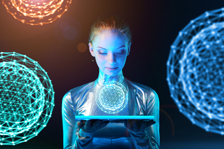 Photo for Futuristic cyber young woman in silver clothing holding lighting panel in her hands with glowing polygonal abstract sphere with abstract spheres at background - Royalty Free Image