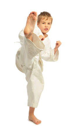 Karate boy kick a leg