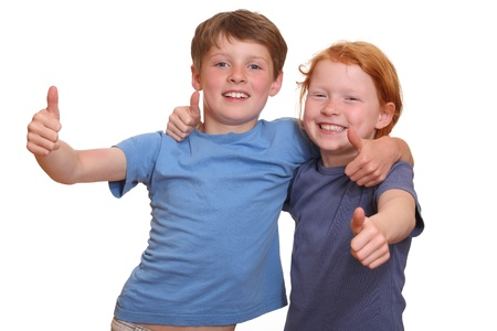 Two happy young kids with thumbs up