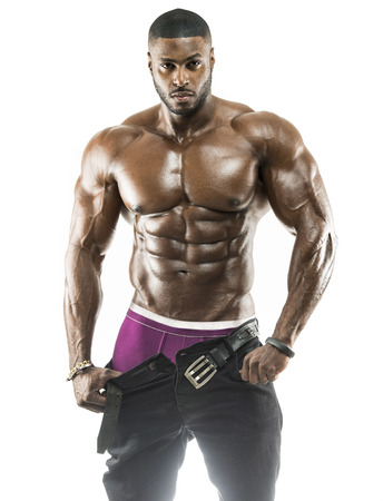 Photo pour Handsome muscular Arabic Black man removing his pants showing abs and black under wear with oiled body - image libre de droit