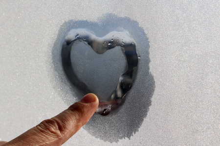 Heart on the frozen glass