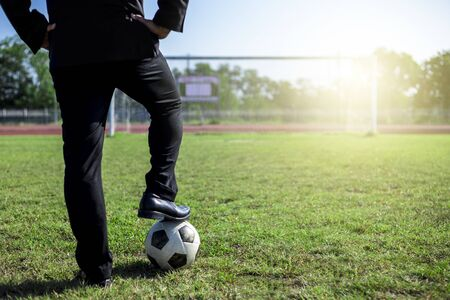 Photo pour business man in working suit with football standing in front of goal, vission, destination - image libre de droit