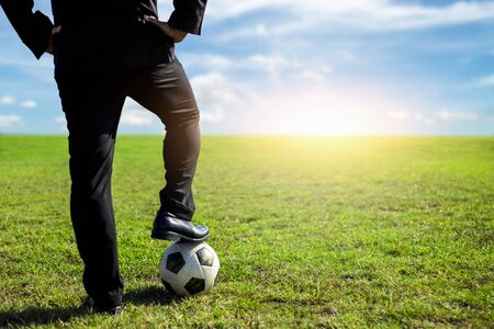 Foto de businessman with a soccer ball on a pitch.Business sport concept - Imagen libre de derechos