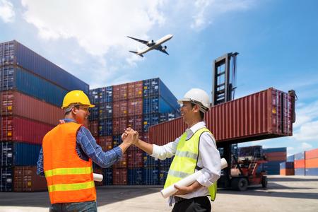 Foto de Foreman and Businessman control loading Containers box from Cargo freight ship - Imagen libre de derechos