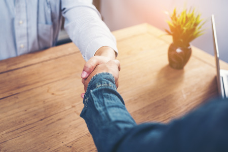 Photo for Casual business people shake hands after successful business negotiations. - Royalty Free Image