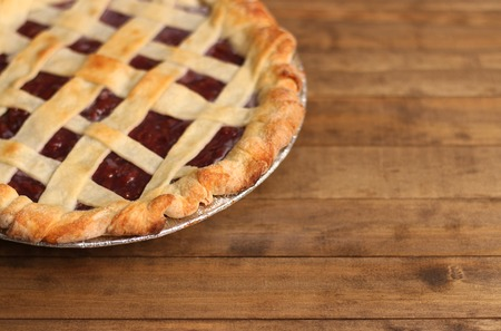 Photo for Homemade Cherry Pie in a Foil Baking Tin - Royalty Free Image
