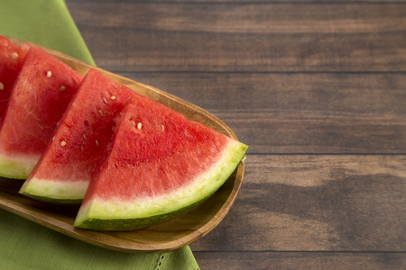 Photo for Fresh Seedless Summer Watermelon on a Wooden Table - Royalty Free Image