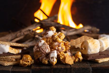 Foto de A Pile of Smore Flavored Popcorn at a Campout - Imagen libre de derechos
