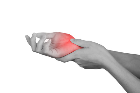 Foto de Acute pain in a wrist. healthcare and problem concept - isolated on white background with clipping path. - Imagen libre de derechos