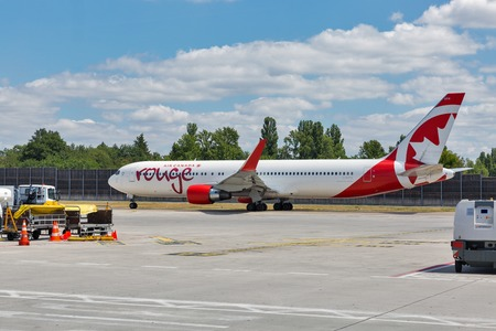 Foto de BERLIN, GERMANY - JULY 15, 2018: Air Canada Boeing 767-300ER passenger plane in Rouge colours at Tegel Otto Lilienthal international airport. Rouge is a low-cost airline and subsidiary of Air Canada. - Imagen libre de derechos