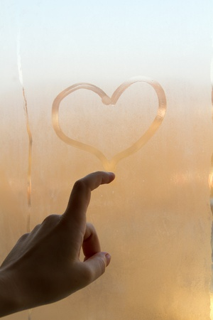 Sweaty drawing hearts on the window