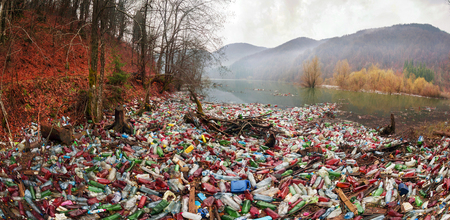 Foto de poor culture of consumption to achieve the progress of modern civilization gives a negative impact on the surrounding nature. Ecological catastrophe in the background of Carpathians - Imagen libre de derechos
