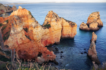 Foto de Famous beaches, cliffs and the sea in Lagos, Portugal attract many tourists and vacationers in the summer, and almost deserted in the winter, even though it is warm there - Imagen libre de derechos