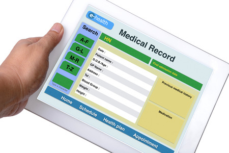Photo pour Patient medical record browse on tablet in someone hand on white background. - image libre de droit