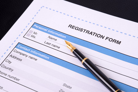 Photo pour Blank registration form with a black pen. - image libre de droit