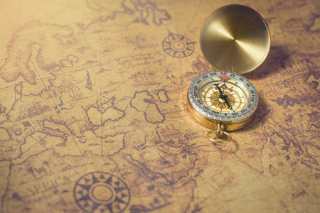 Photo for Old compass on vintage map. - Royalty Free Image