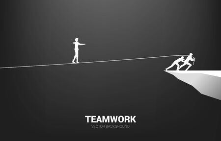 Illustrazione per Silhouette of businessman walking on rope walk way pulled by team.Concept for teamwork and team support.. - Immagini Royalty Free