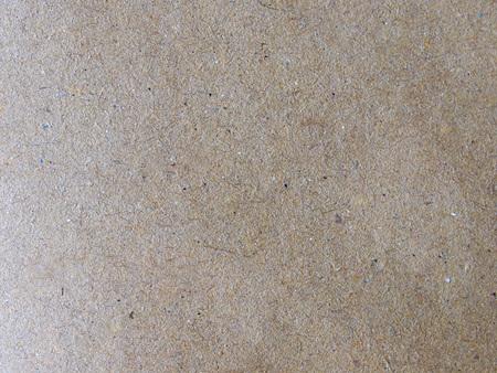Foto de brown paperboard surface useful as a background - Imagen libre de derechos