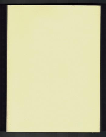 Foto de Close up of a yellow paperboard cover of a book - Imagen libre de derechos