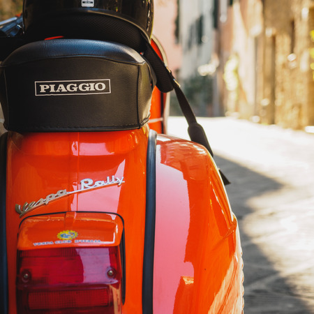 Photo for Vintage Vespa Piaggio parked in a street of a Tuscan town. Italy, 2017. - Royalty Free Image