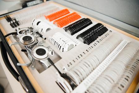 Foto de Suitcase with colored ophthalmic lenses black, white, orange. Special glasses for selection - Imagen libre de derechos