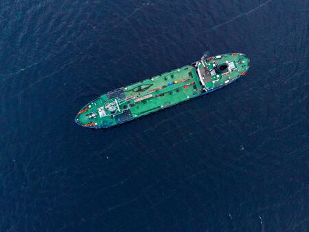 Photo pour Oil chemical tanker sails blue sea fog. Aerial top view - image libre de droit
