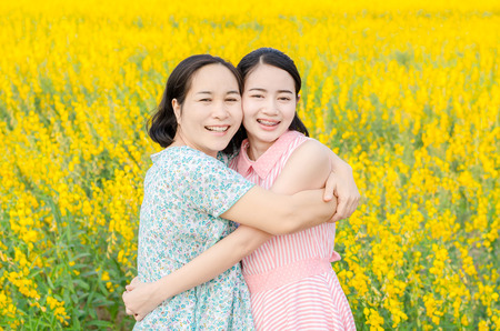 Photo for Asian mother and her daughter at flower field - Royalty Free Image