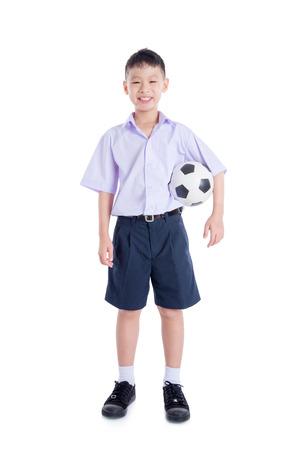 Foto de Young asian schoolboy over white - Imagen libre de derechos