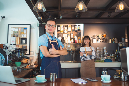 Photo for Asian barista in coffee shop - Royalty Free Image