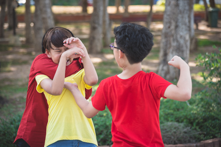 Photo for Young asian boy bullied by two boys in park - Royalty Free Image