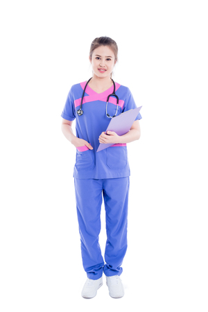 Photo for Full length of beautiful asian nurse standing over white background - Royalty Free Image