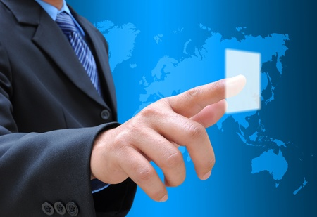 Photo for businessman hand pushing button on a touch screen interface - Royalty Free Image