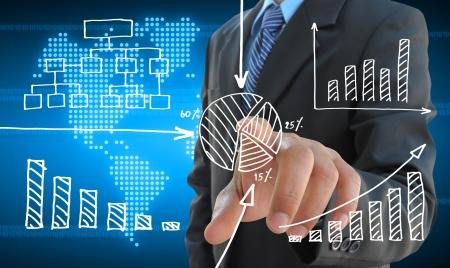 Photo pour businessman hand pushing a business graph on a touch screen interface - image libre de droit
