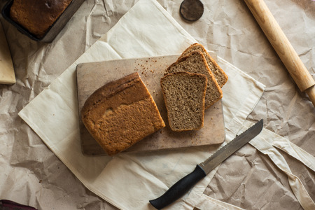 Photo pour beautiful food photo of fresh homemade sourdough wheat form bread  served on the rustic background - image libre de droit