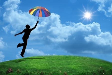 Photo pour man jumping with umbrella - image libre de droit