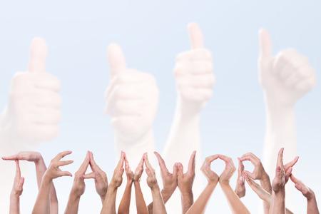 Foto de the word teamwork in front of hands holding thumbs up - Imagen libre de derechos