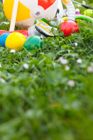 spring or summer with various outdoor fun equipment, green meadow
