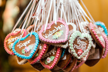 Photo for lots of Gingerbread hearts with german words and messages, concept christmas market or octoberfest, funfair - Royalty Free Image