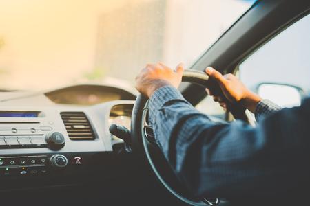 Photo pour Hands male driving in his car. - image libre de droit