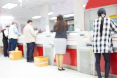 Photo pour Blur image of post office interior and people - customer service - image libre de droit