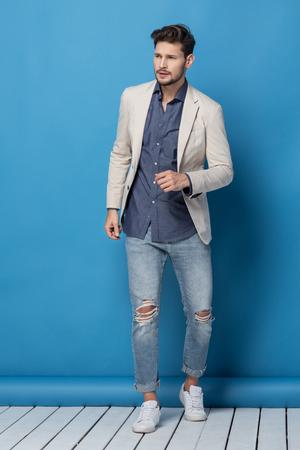 Foto de Happy handsome man over blue background - Imagen libre de derechos