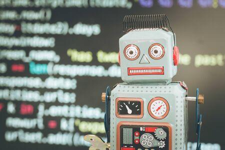 Foto de Symbol for a chatbot or social bot and algorithms, program code in the background - Imagen libre de derechos