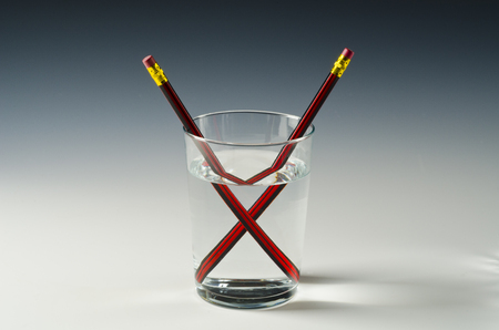 Foto de A pencil in a glass of water shows light refraction. - Imagen libre de derechos