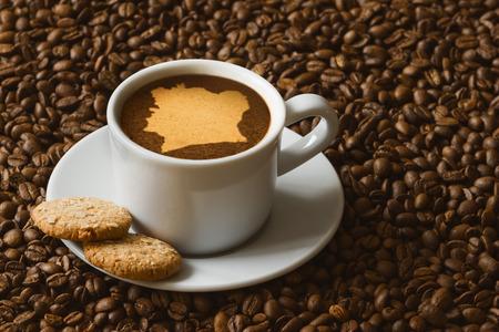 Foto de Still life photography of hot coffee beverage with map of Ivory Coast - Imagen libre de derechos