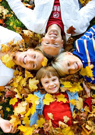 a cute family in autumn