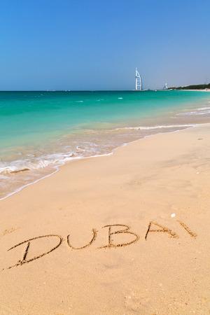 Dubai written on the beach