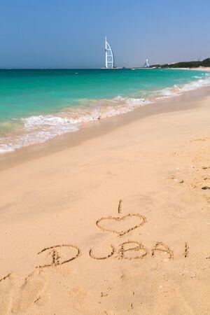 I love Dubai written on the beach
