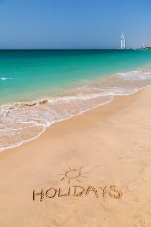 Holidays written on the beach