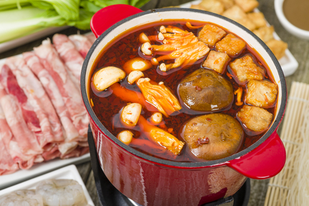 Photo for Szechuan Hot Pot - Spicy Chinese hot pot with beef, tofu, prawns, mushrooms, green leaves and noodles. - Royalty Free Image