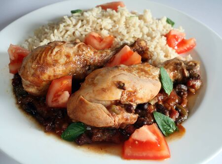 Traditional Cuban chicken drumsticks in black bean and tomato sauce, served with brown rice.